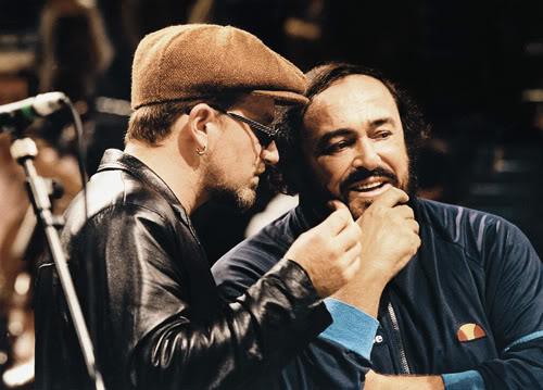 Luciano Pavarotti with U2 singer Bono. Italian tenor, b. 1935.